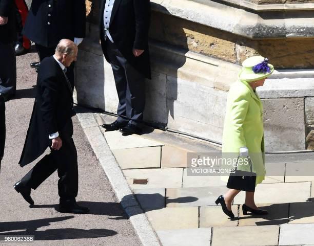 Britain's Queen Elizabeth II and Britain's Prince Philip Duke of Edinburgh arrive for the wedding ceremony of Britain's Prince Harry Duke of Sussex...