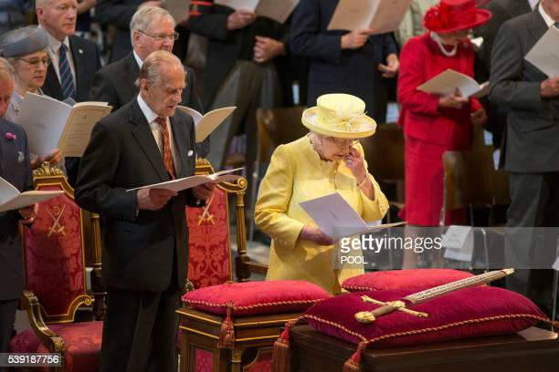 Britain's Queen Elizabeth II and Britain's Prince Philip, Duke of Edinburgh hold their orders of service during a national service of thanksgiving...