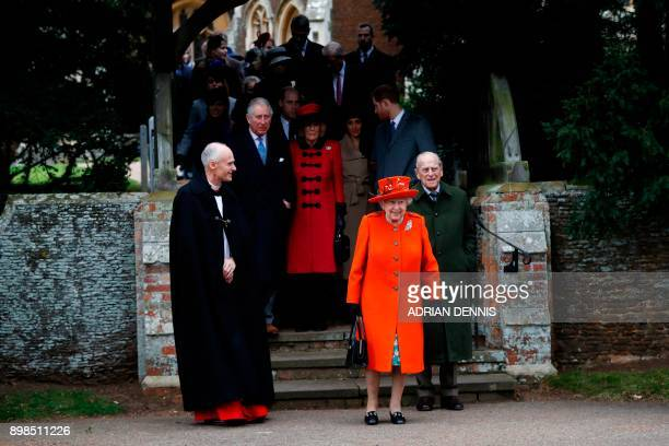 Britain's Queen Elizabeth II and Britain's Prince Philip, Duke of Edinburgh lead out other members of the family with Reverend Canon Jonathan Riviere...