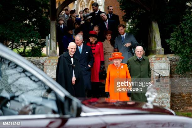 Britain's Queen Elizabeth II and Britain's Prince Philip Duke of Edinburgh lead out other members of the family with Reverend Canon Jonathan Riviere...
