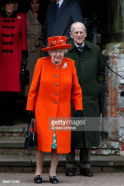 Britain's Queen Elizabeth II and Britain's Prince Philip Duke of Edinburgh lead out other members of the family as they leave after attending the...