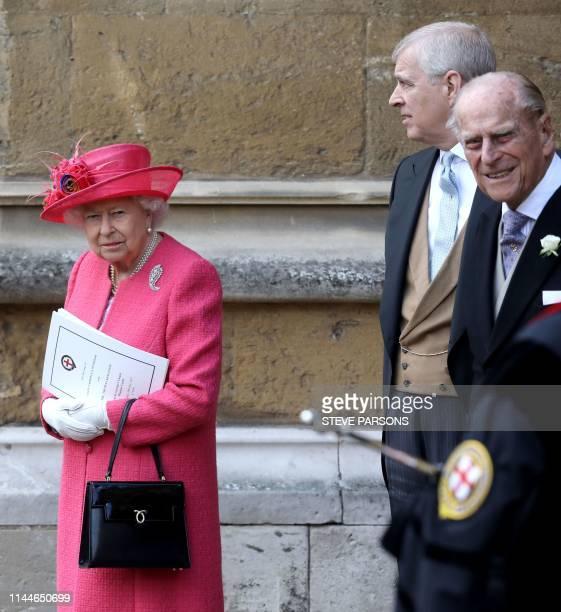 Britain's Queen Elizabeth II and Britain's Prince Philip Duke of Edinburgh leave St George's Chapel in Windsor Castle Windsor west of London on May...