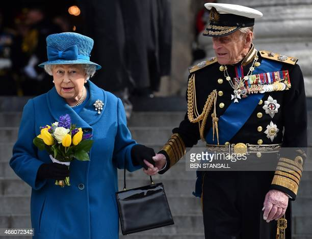 Britain's Queen Elizabeth II and Britain's Prince Philip, Duke of Edinburgh, leave St Paul's Cathedral in London on March 13 after attending a...