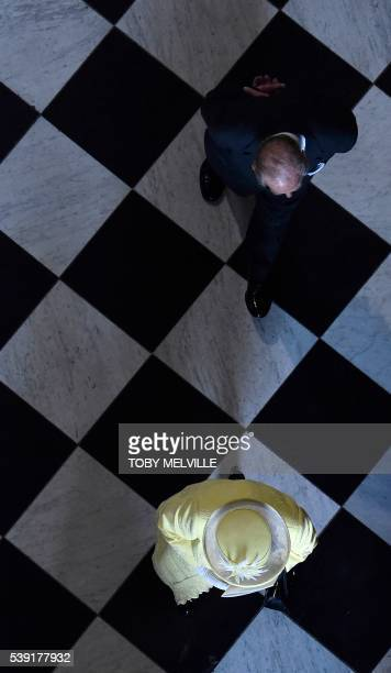 Britain's Queen Elizabeth II and Britain's Prince Philip, Duke of Edinburgh leave at the end of a national service of thanksgiving for the Queen's...