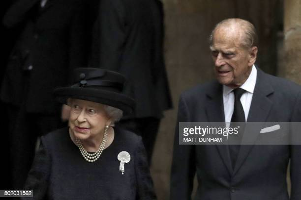 Britain's Queen Elizabeth II and Britain's Prince Philip Duke of Edinburgh leave after the funeral service of the 2nd Countess Mountbatten of Burma...