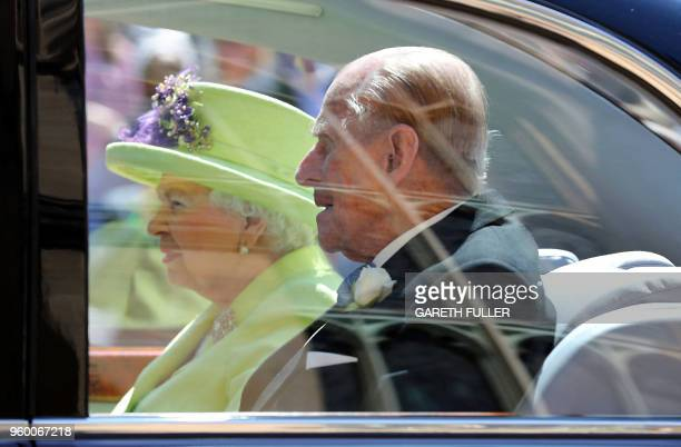 Britain's Queen Elizabeth II and Britain's Prince Philip Duke of Edinburgh leave after attending the wedding ceremony of Britain's Prince Harry Duke...