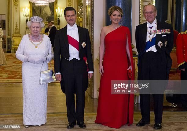 Britain's Queen Elizabeth II and Britain's Prince Philip Duke of Edinburgh pose for a photograph with Mexican President Enrique Pena Nieto and his...