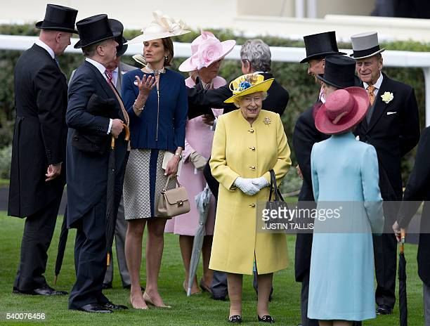 Britain's Queen Elizabeth II and Britain's Prince Philip Duke of Edinburgh speak to guest in the parade ring on the first day of the Royal Ascot...