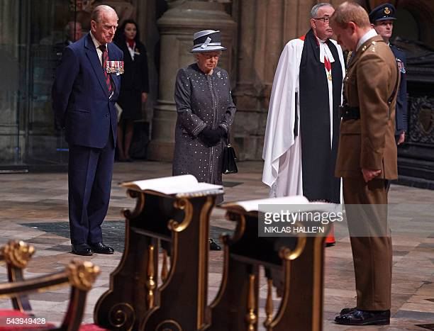 Britain's Queen Elizabeth II and Britain's Prince Philip Duke of Edinburgh stand after the bugler finishes playing at the end of a Service on the Eve...