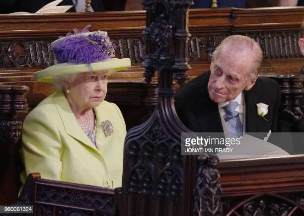 Britain's Queen Elizabeth II and Britain's Prince Philip Duke of Edinburgh during the wedding ceremony of Britain's Prince Harry Duke of Sussex and...