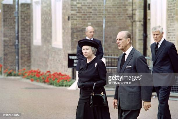 Britain's Queen Elizabeth II and Britain's Prince Philip, Duke of Edinburgh arrive to pay their respects to Diana 's body in the Chapel Royal on the...