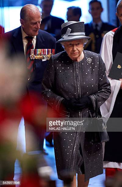 Britain's Queen Elizabeth II and Britain's Prince Philip Duke of Edinburgh arrive to attend a Service on the Eve of the Centenary of the Battle of...