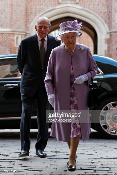 Britain's Queen Elizabeth II and Britain's Prince Philip Duke of Edinburgh arrive to attend Evensong in celebration of the centenary of the Order of...