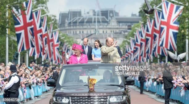 Britain's Queen Elizabeth II and Britain's Prince Philip Duke of Edinburgh wave to guests as they are followed in a convoy by Britain's Prince...