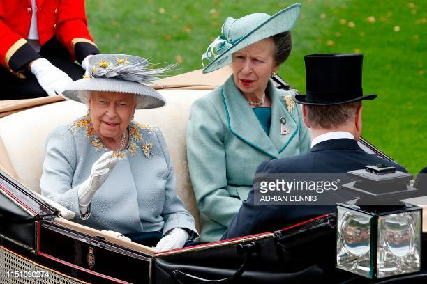 Britain's Queen Elizabeth II and Britain's Princess Anne Princess Royal arrive by horsedrawn carriage to attend day three of the Royal Ascot horse...