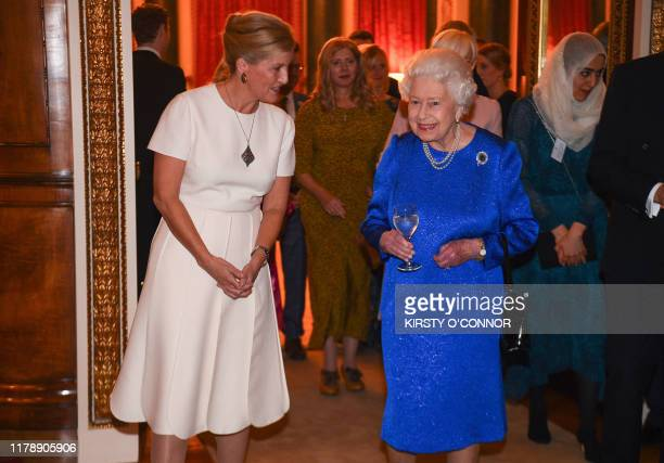 Britain's Queen Elizabeth II and Britain's Sophie, Countess of Wessex, attend a reception at Buckingham Palace in London on October 29 to celebrate...