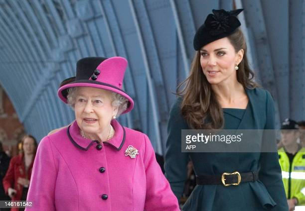 Britain's Queen Elizabeth II and Catherine Duchess of Cambridge arrive at Kings Cross St Pancras Station London before boarding a train to visit...