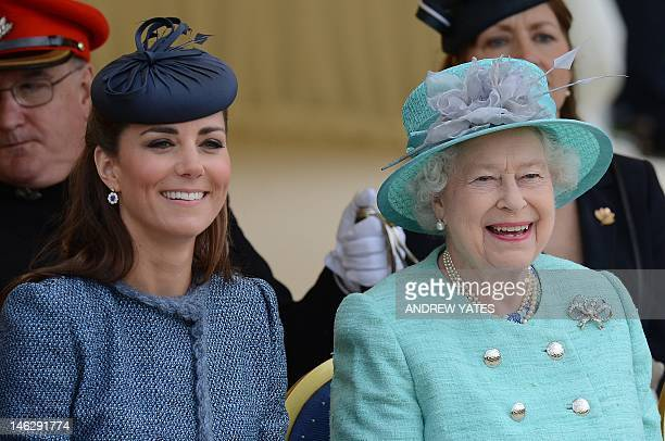 Britain's Queen Elizabeth II and Catherine Duchess of Cambridge reacts as they watch Prince William start a children's race during a sports...