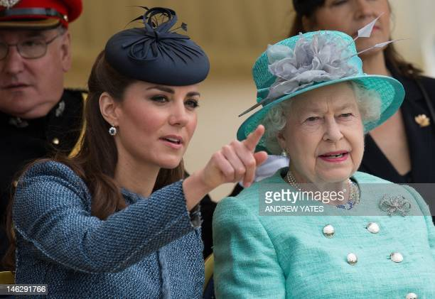 Britain's Queen Elizabeth II and Catherine Duchess of Cambridge watch as Prince William starts a children's race during a sports demonstration on...