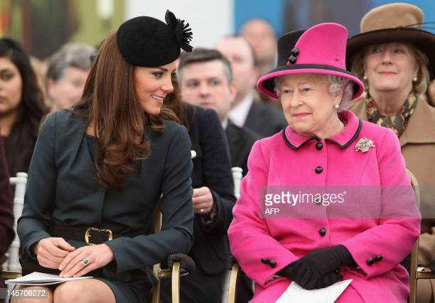 Britain's Queen Elizabeth II and Catherine The Duchess of Cambridge speak as they visit De Montfort University in Leicester central England on March...