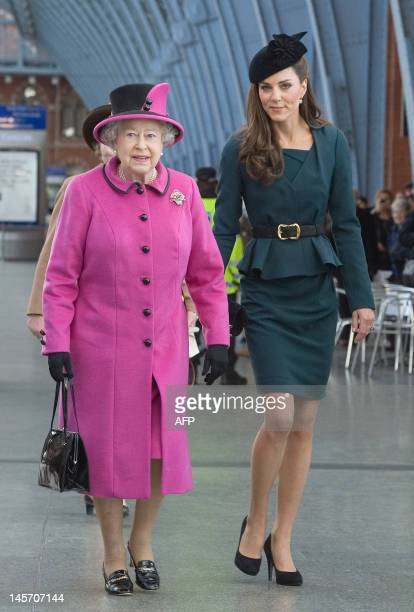 Britain's Queen Elizabeth II and Catherine The Duchess of Cambridge arrive at Kings Cross St Pancras Station in north London on March 8 before...