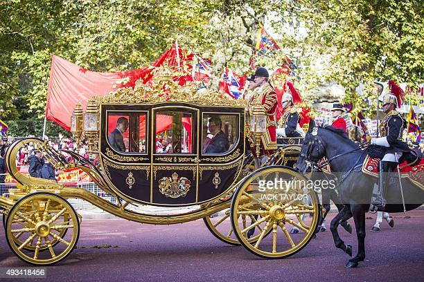 Britain's Queen Elizabeth II and China's President Xi Jinping travel together in the Diamond Jubilee State Coach along the Mall to Buckingham Palace...