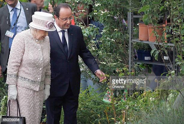 "Britain's Queen Elizabeth II and French President Francois Hollande visit the newly renamed ""Queen Elizabeth II"" flower market on June 7 in Paris,..."