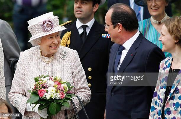 "Britain's Queen Elizabeth II and French President, Francois Hollande visit the newly renamed ""Queen Elizabeth II"" flower market on June 7 in Paris."