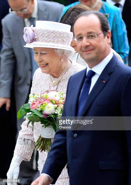 Britain's Queen Elizabeth II and French President Francois Hollande visit the newly renamed 'Queen Elizabeth II' flower market on June 7 in Paris...