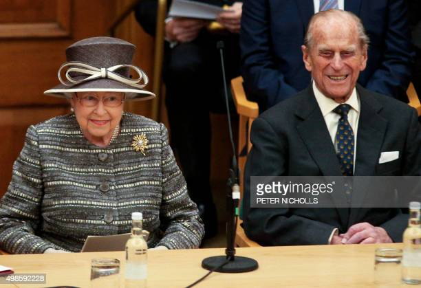 Britain's Queen Elizabeth II and her husband Britain's Prince Philip Duke of Edinburgh attend the inauguration ceremony of the tenth General Synod of...