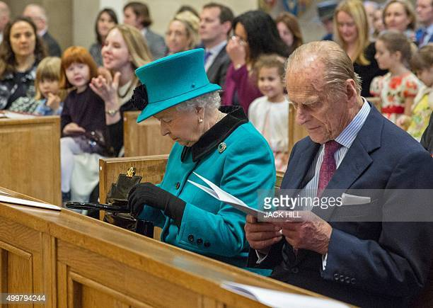 Britain's Queen Elizabeth II and her husband Britain's Prince Philip Duke of Edinburgh attend a service of thanksgiving at St Columbas Church of...
