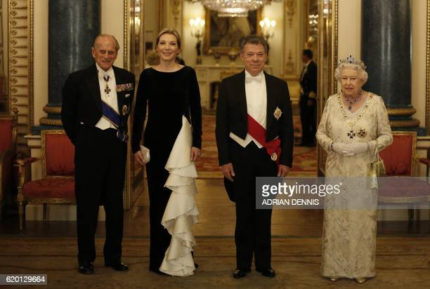Britain's Queen Elizabeth II and her husband Britain's Prince Philip Duke of Edinburgh pose with Colombia's President Juan Manuel Santos and his wife...