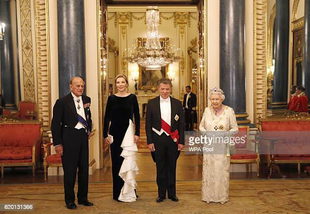 Britain's Queen Elizabeth II and her husband Britain's Prince Philip, Duke of Edinburgh , pose with Colombia's President Juan Manuel Santos and his...