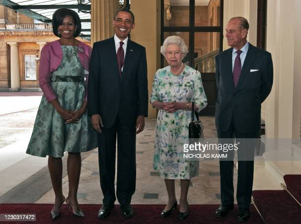 Britain's Queen Elizabeth II and her husband Prince Philip greet US President Barack Obama and his wife Michelle at Buckingham Palace in London on...