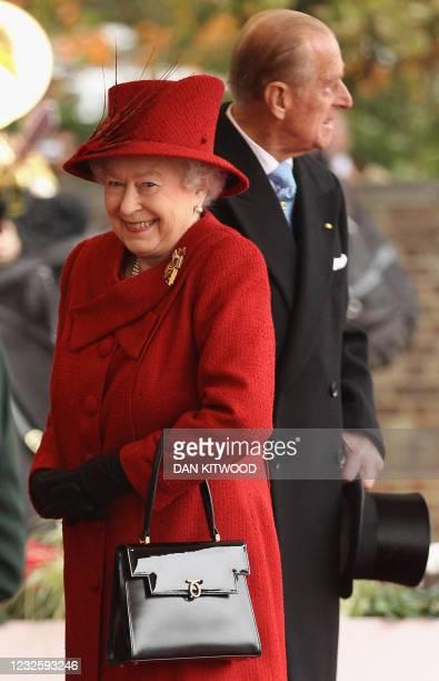 Britain's Queen Elizabeth II and her husband Prince Philip wait to greet Qatar's emir, Sheikh Hamad bin Khalifa al-Thani, and his wife Sheikha Mozah,...