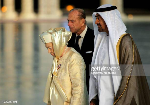 Britain's Queen Elizabeth II and her husband Prince Philip walk with Abu Dhabi Crown Prince Sheikh Mohammed bin Zayed al-Nahayan upon their arrival...