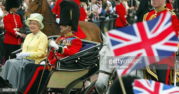 Britain's Queen Elizabeth II and her husband the Duke of Edinburgh arrive at Buckingham Palace after attending the Trooping The Colour ceremony to...