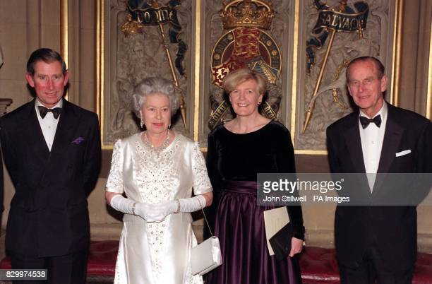 Britain's Queen Elizabeth II and her husband The Duke of Edinburgh accompanied by the couples eldest son the Prince of Wales attend a dinner hosted...
