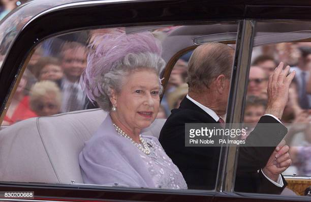 Britain's Queen Elizabeth II and her husband the Duke of Edinburgh arrive for the wedding of their youngest son Prince Edward to Sophie RhysJones at...
