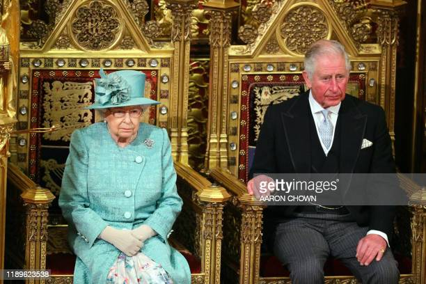 Britain's Queen Elizabeth II and her son Britain's Prince Charles Prince of Wales sit in the House of Lords chamber during the State Opening of...