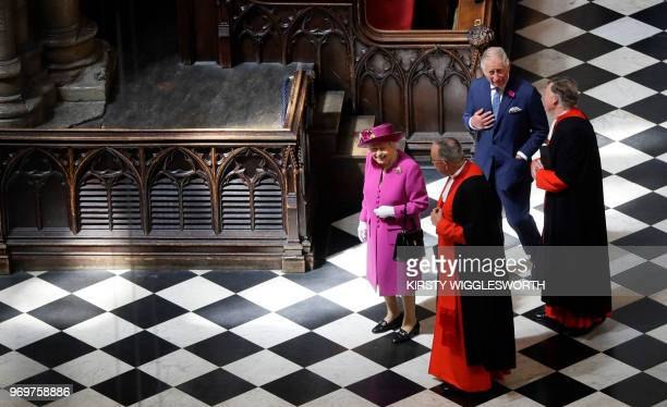 Britain's Queen Elizabeth II and her son Britain's Prince Charles Prince of Wales arrive to open 'The Queen's Diamond Jubilee Galleries' at...