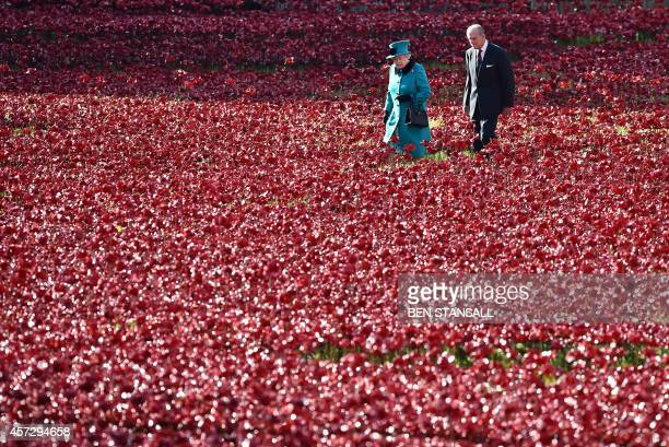 Britain's Queen Elizabeth II and husband Prince Philip, Duke of Edinburgh, visit the Tower of London's 'Blood Swept Lands and Seas of Red' poppy...