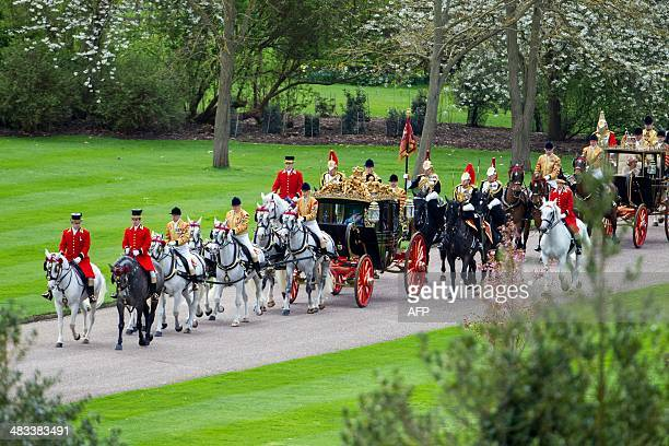 Britain's Queen Elizabeth II and Irish President Michael D Higgins travel to Windsor Castle in a State Carriage Procession during his state visit in...