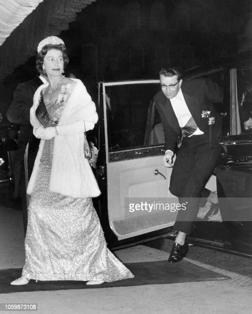 Britain's Queen Elizabeth II and King Baudouin of Belgium arrive at the Royal Opera House in London on May 16, 1963.