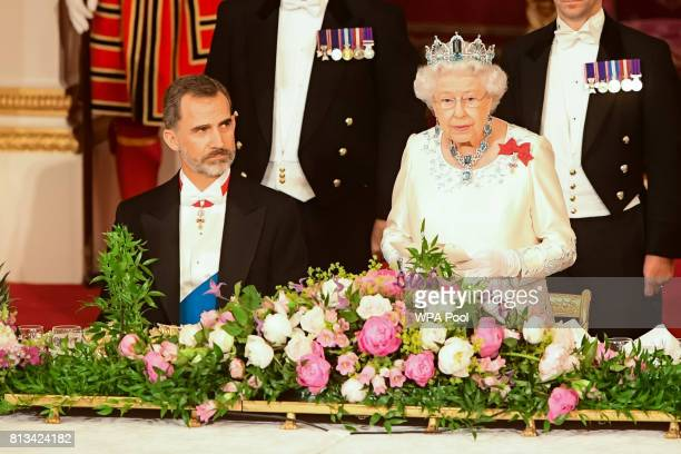 Britain's Queen Elizabeth II and King Felipe VI of Spain attend a State Banquet at Buckingham Palace on July 12 2017 in London England This is the...