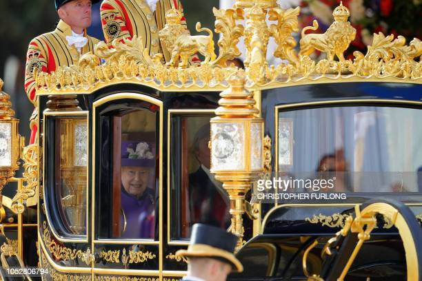 Britain's Queen Elizabeth II and King Willem-Alexander of the Netherlands ride together in the State Coach Britannia from a Ceremonial Welcome on...