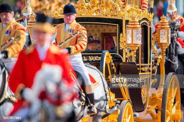 Britain's Queen Elizabeth II and King Willem-Alexander of the Netherlands ride together in the State Coach Britannia on the way to Buckingham Palace...