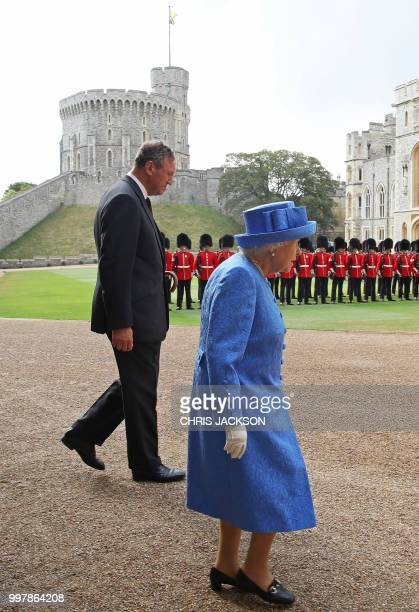 Britain's Queen Elizabeth II and Lieutenant Colonel Sir Andrew Ford walk out to await the arrival of US President Donald Trump and US First Lady...