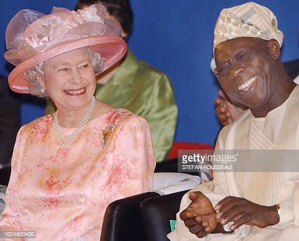 Britain's Queen Elizabeth II and Nigerian President Olusegun Obasanjo smile at the official opening of the Commonwealth Heads of Government Meeting...