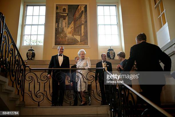 Britain's Queen Elizabeth II and President George W Bush watch as former President George HW Bush arrives at a dinner at the British Embassy in...